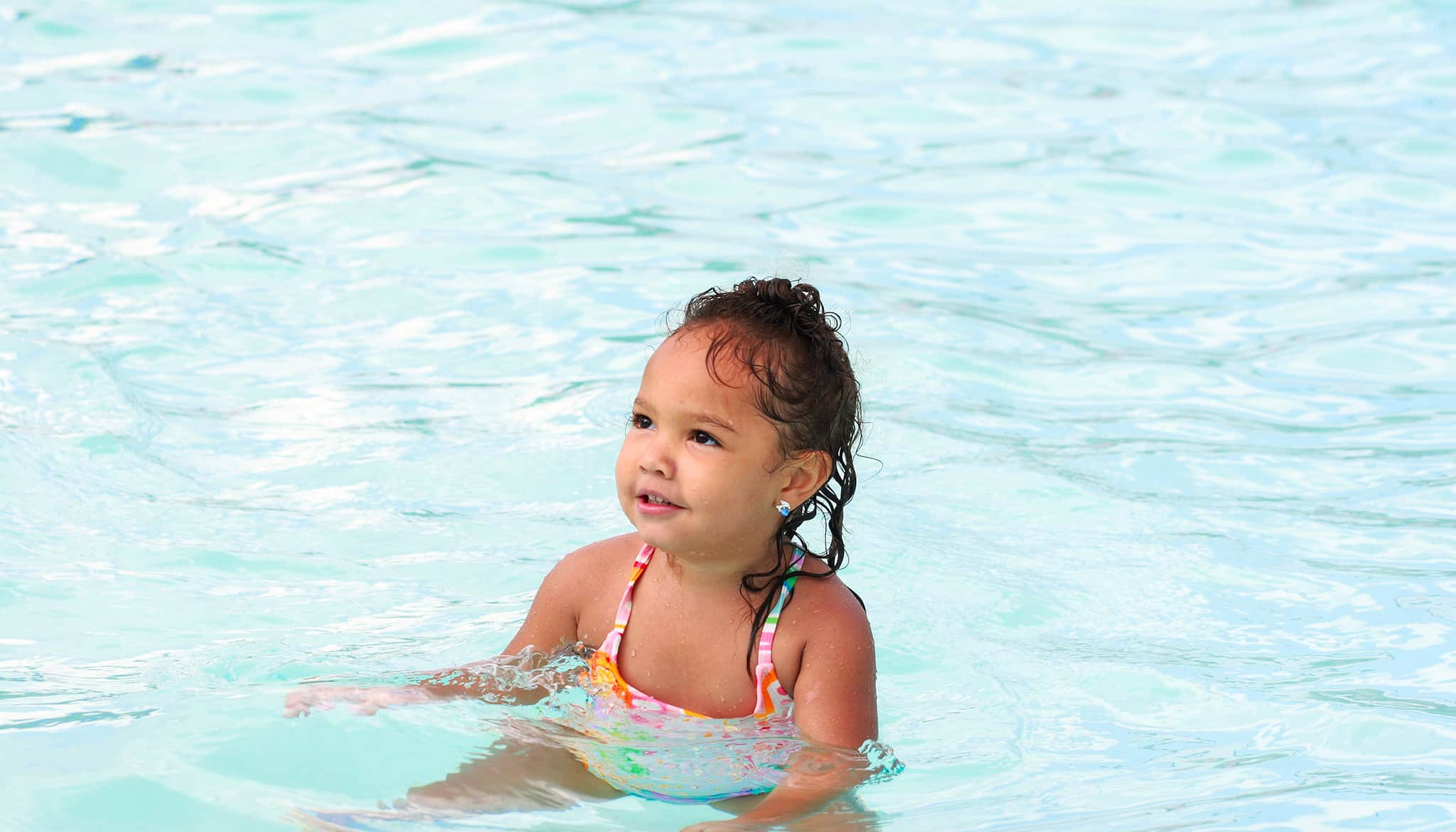 Toddler enjoying a swimming pool